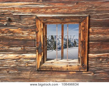 View through a wooden window on a winter landscape
