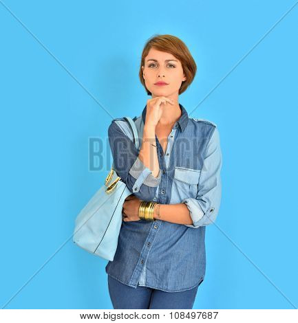 Smiling attractive girl standing on blue background