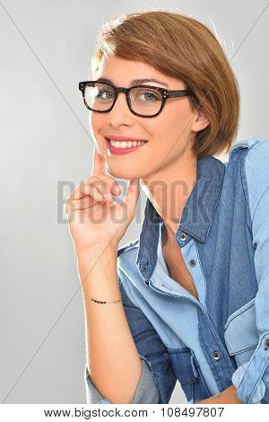 Portrait of young woman wearing eyeglasses, isolated