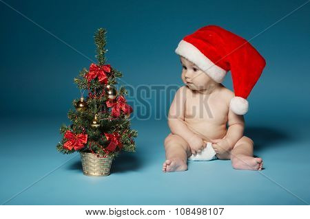 boy in diapers with hat of Santa Claus