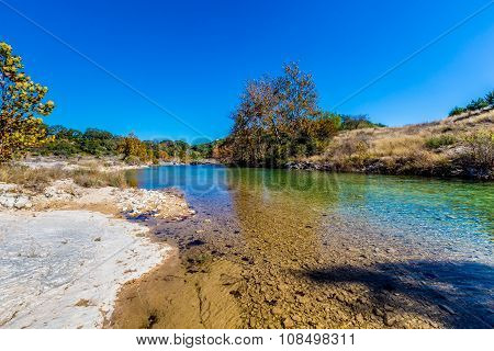Fall Foliage On A Crystal Clear Creek In The Hill Country Of Texas