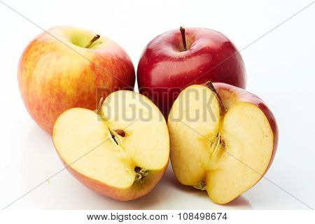 Two apples and half on white