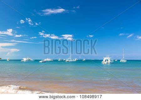 Yachts over ocean water background