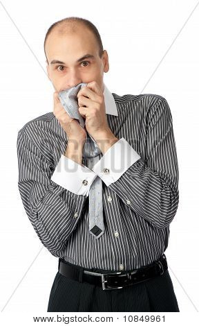 Worried Business Man Holding His Hands To Mouth