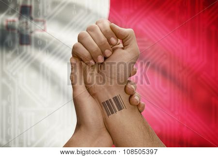 Barcode Id Number On Wrist Of Dark Skinned Person And National Flag On Background - Malta
