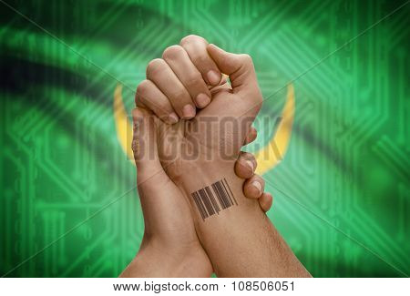 Barcode Id Number On Wrist Of Dark Skinned Person And National Flag On Background - Mauritania