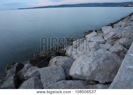 Stones On The Seashore In The Evening In Koper In Slovenia