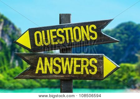 Questions Answers signpost in a beach background