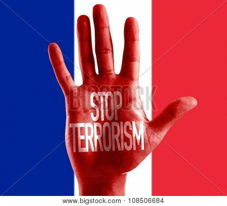Stop Terrorism painted on hand with French Flag on background