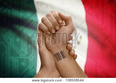 Barcode Id Number On Wrist Of Dark Skinned Person And National Flag On Background - Mexico