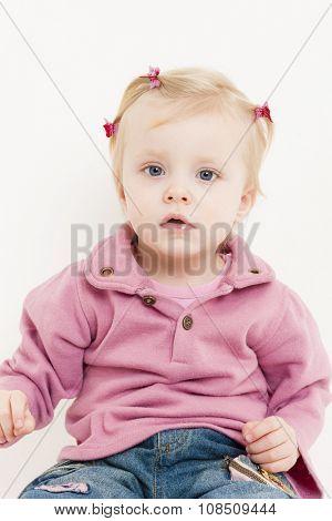 portrait of sitting little girl wearing jeans