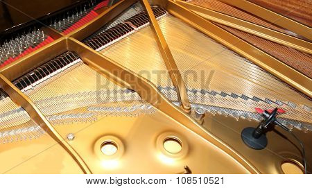 Inside Of A Piano With Little Hammer And Strings