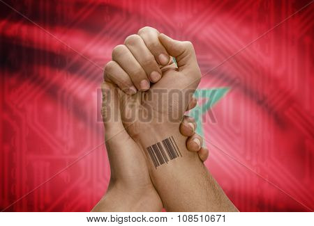 Barcode Id Number On Wrist Of Dark Skinned Person And National Flag On Background - Morocco