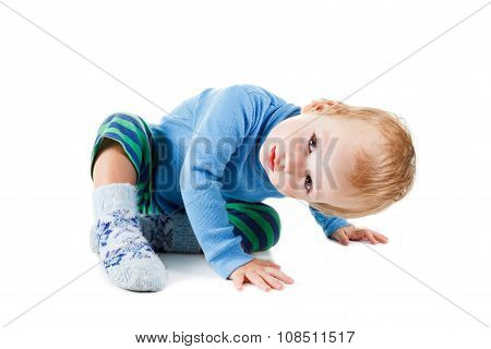 Cute Happy Baby Blonde In A Blue Sweater Playing And Smiling On White Background