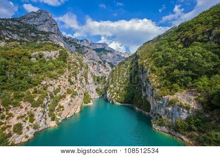 Provence, Mercantour National Park.  The rocky slopes of the canyon Verdon descend into the azure river