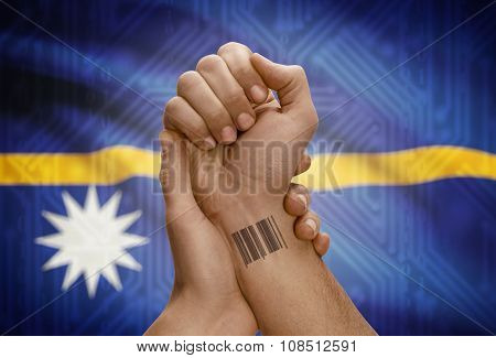 Barcode Id Number On Wrist Of Dark Skinned Person And National Flag On Background - Nauru