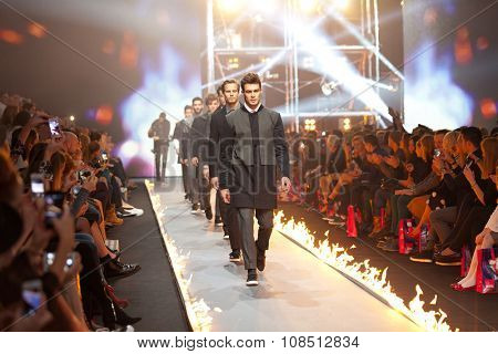ZAGREB, CROATIA - OCTOBER 31, 2015: Fashion model wearing clothes designed by IK Studio on the 'Fashion.hr' fashion show