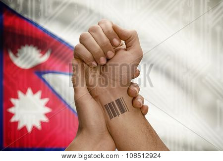 Barcode Id Number On Wrist Of Dark Skinned Person And National Flag On Background - Nepal