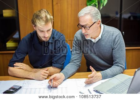Two employees at work in an office