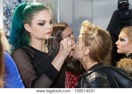 ZAGREB, CROATIA - OCTOBER 31, 2015: Fashion model undergoing makeup process in backstage of the 'Fashion.hr' fashion show