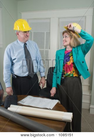 Architect And Client Looking At Blueprints 5