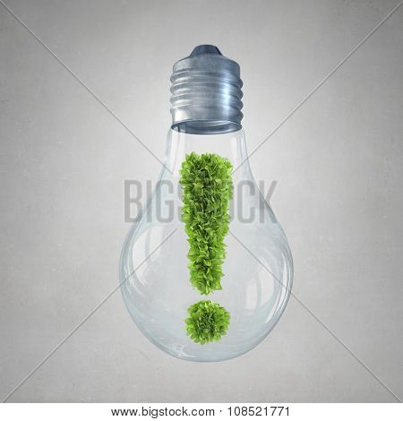 Glass light bulb with green exclamation mark inside