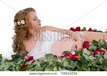 Sensual expectant mother posing with roses