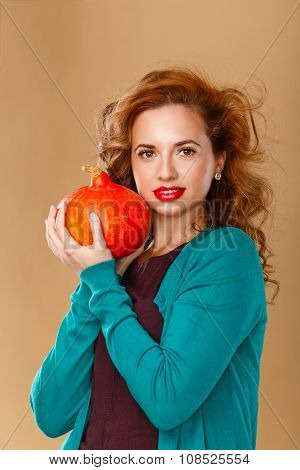 Girl With A Clean Skin Holding A Pumpkin.