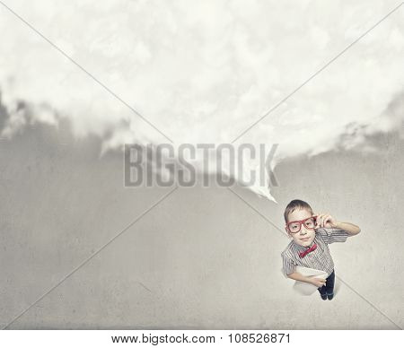 Wideangle picture of funny schoolboy with paper plane in hand