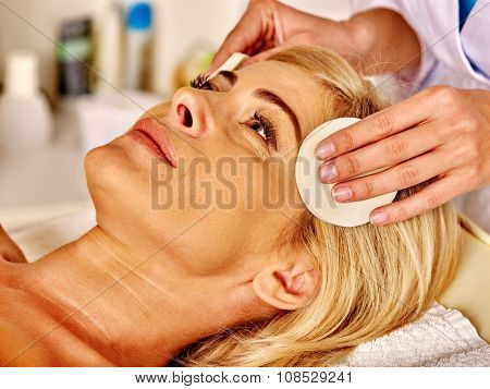 Portrait of woman middle-aged take face cleaning in spa salon.