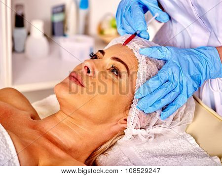 Woman middle-aged in spa salon with beautician. Beauty woman giving botox injections. Medicine and beauty.