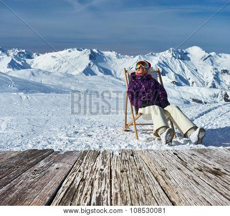 Woman at mountains in Santa hat celebrating christmas, Meribel, Alps, France