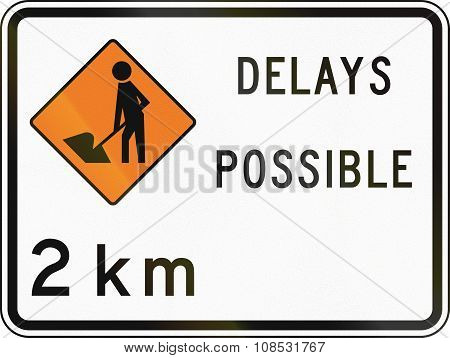 New Zealand Road Sign - Road Workers Ahead In 2 Kilometres, Delays Possible