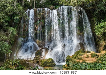 Waterfall In A Lush Rainforest. Beautiful Waterfalls Or Cascades In El Nicho  In Scambray Mountains.