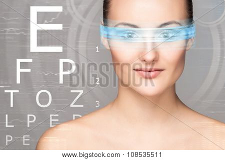 Beautiful woman with eye scanning over grey background.