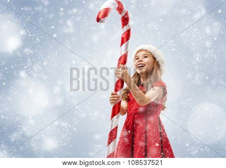 Christmas Eve! Happy child with a huge Christmas Lollipop