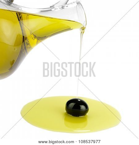Pouring Oil on Single Black Olive