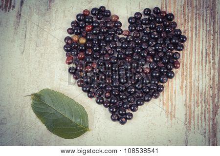 Vintage Photo, Heart Of Elderberry On Old Wooden Background, Symbol Of Love