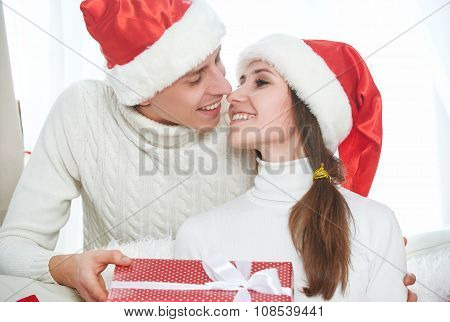 Christmas Gift. Man Gives A Woman Gift Present Box