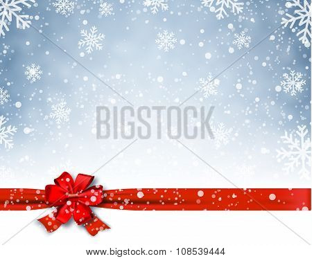 Winter background with red bow