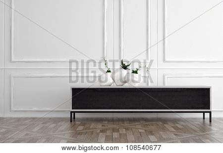 Modern black side table in a classic white wood panelled room with natural hardwood floor with three contemporary vases displayed on top. 3d Rendering.
