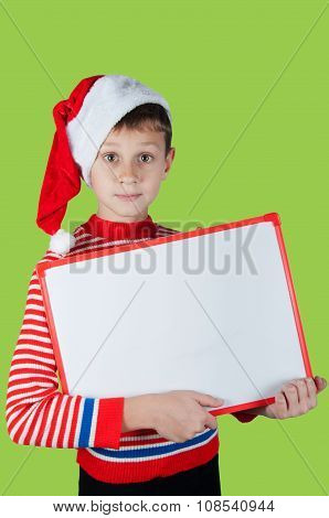 Boy In Christmas Costume Holding White Cardboard On Green Background
