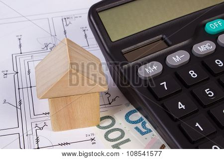 House Of Wooden Blocks And Polish Money With Calculator On Construction Drawing, Building House Conc