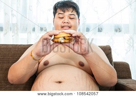 Ffat Man Eating Hamburger Seated
