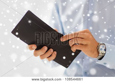 people, business, finances and money concept - close up of businessman hands holding open wallet over snow effect