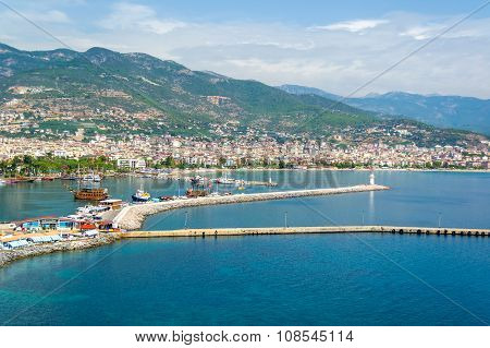 Cruise ships in Alanya harbor and lighthouse, Turkey