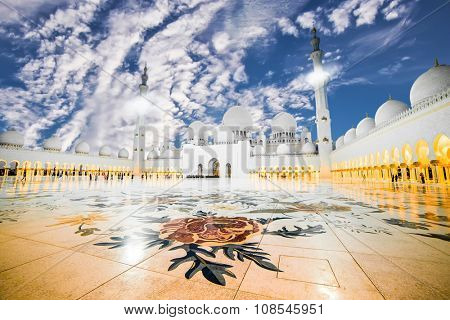 The courtyard of Sheikh Zayed Grand Mosque in Abu Dhabi with two minarets