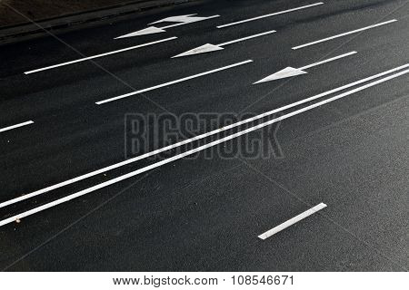 Lines And Arrows On Asphalt Road