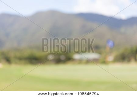 Abstract Blurred Background Of Green Golf Course.