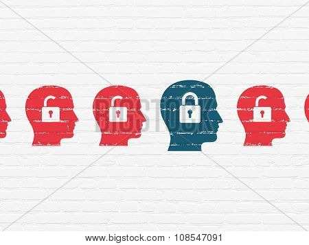 Security concept: head with padlock icon on wall background
